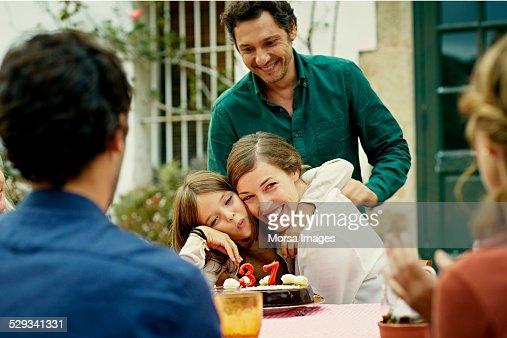 Happy family celebrating birthday in yard