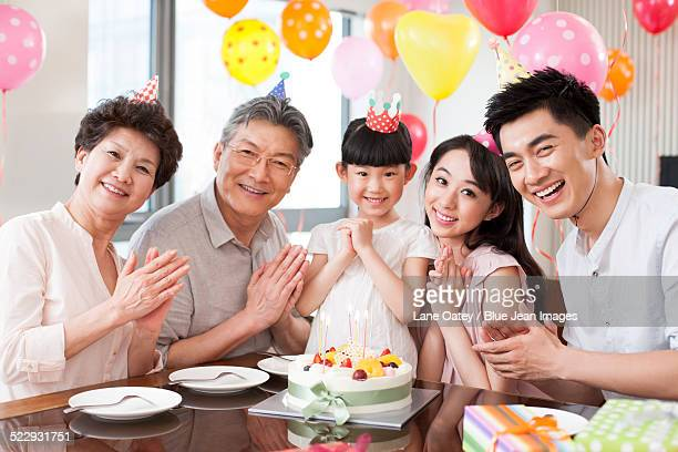 Happy family celebrating birthday