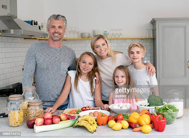 Happy family cooking dinner together