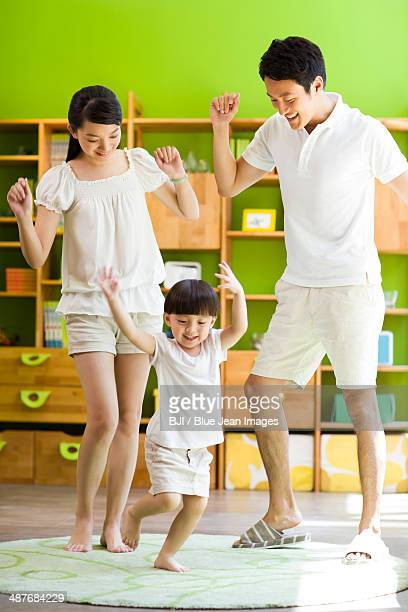 Happy family dancing