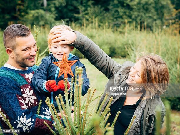 Happy Family Decorating A Christmas Tree