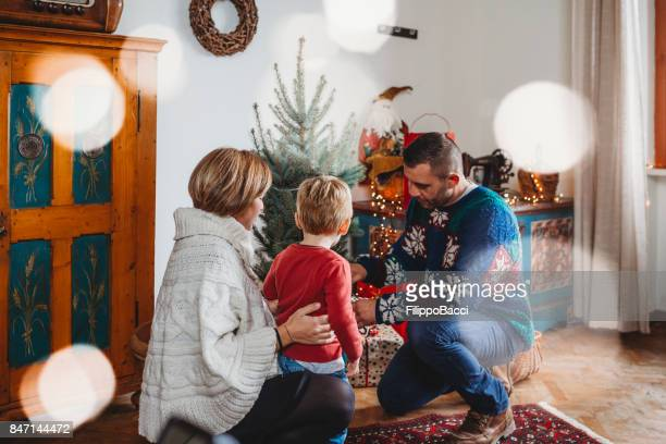 Happy family decorating Christmas tree together