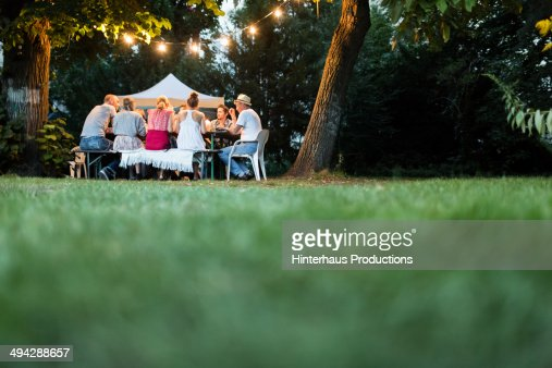 Happy Family Dining In The Garden
