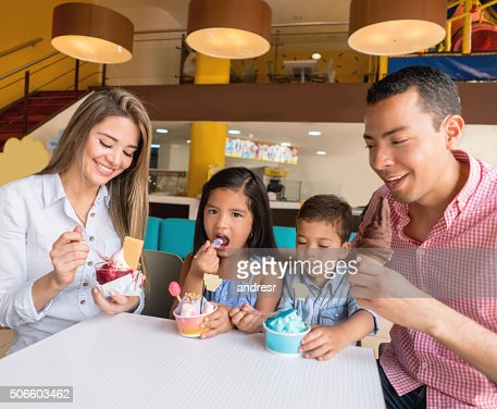 Happy Family Eating An Ice Cream Photo | Getty Images
