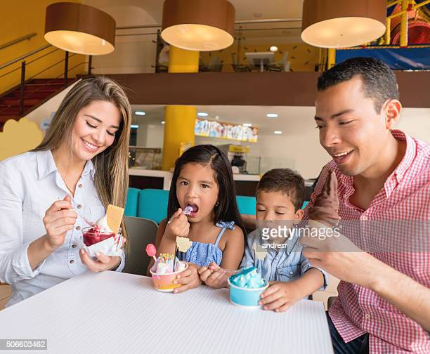 Happy family eating an ice cream