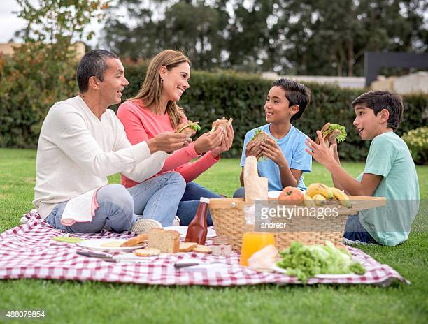 Happy family eating at a pic nic