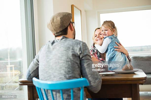 Happy family eating at dining table