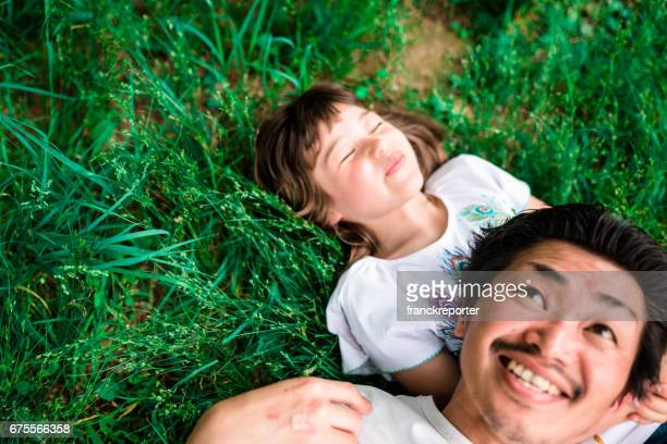 happy family enjoy on the grass lying down