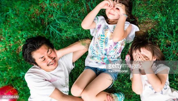 happy family enjoy on the grass lying down
