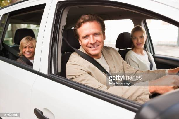 Happy family enjoying a drive in car