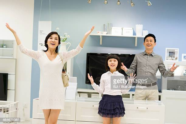 Happy family enjoying fully decorated living room