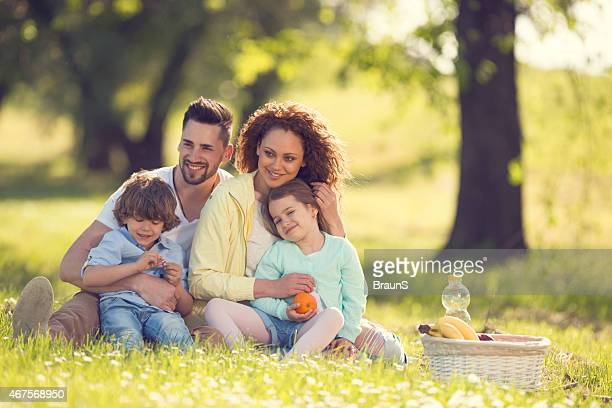 Happy family enjoying in picnic day at the park.