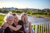 Cheerful multi-generation family enjoying in a public park