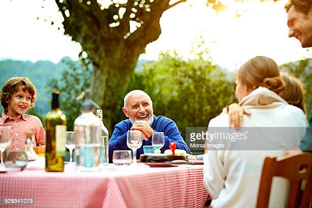 Happy family enjoying meal at outdoor table
