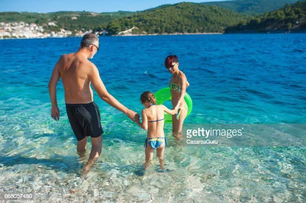 Happy Family Enjoying The Beach Holiday