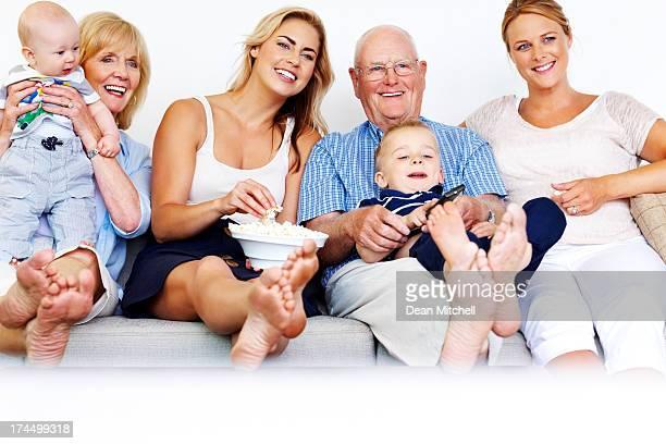 Happy family enjoying watching television