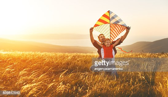 happy family father and baby daughter launch  kite on meadow : Stock Photo