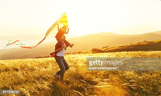 happy family father and child daughter run with  kite on meadow : Foto stock