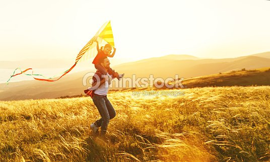 happy family father and child daughter run with  kite on meadow : Stock Photo
