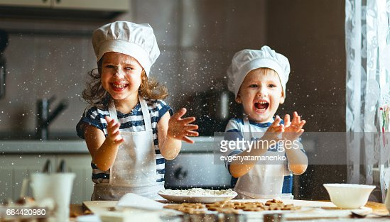 happy family funny kids bake cookies in kitchen : Stock Photo