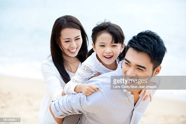 Happy family having a good time on the beach of Repulse Bay, Hong Kong