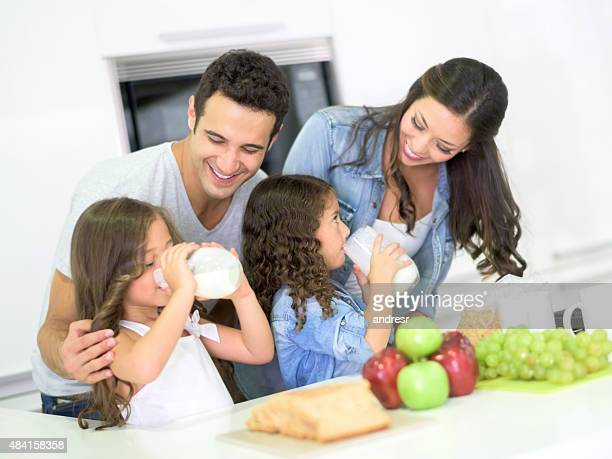 Happy family having breakfast at home
