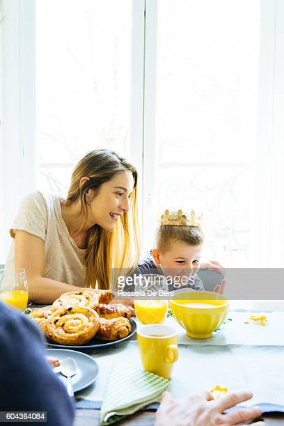 Happy Family Having Breakfast Together At Home And Playing