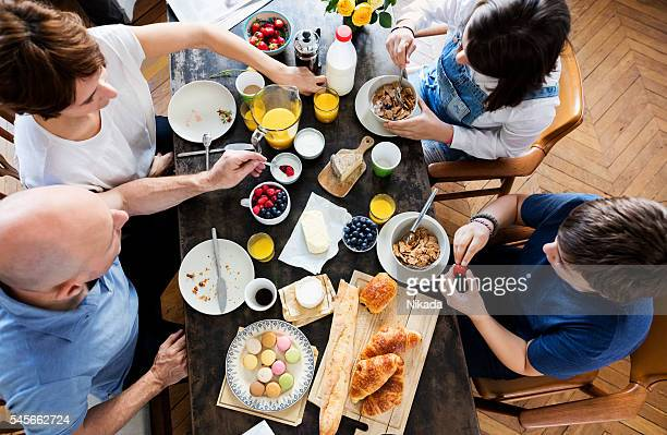 Happy Family Having Breakfast together, Overhead View