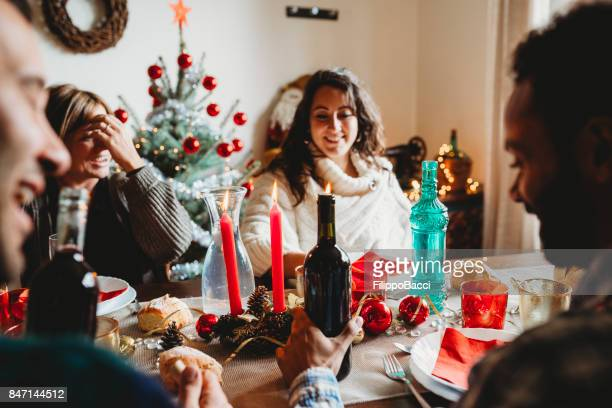 Happy family having Christmas lunch together