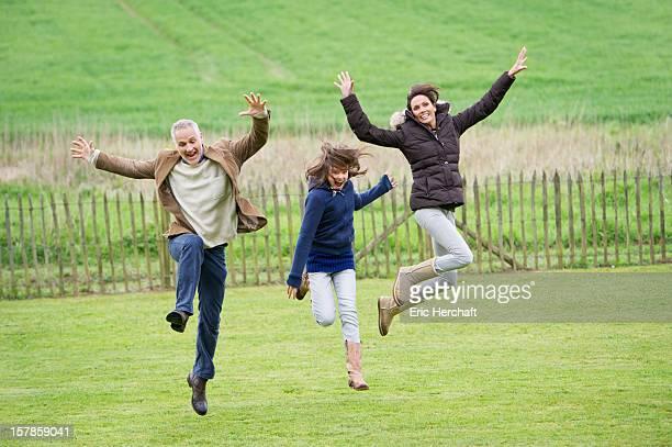 Happy family having fun in a field