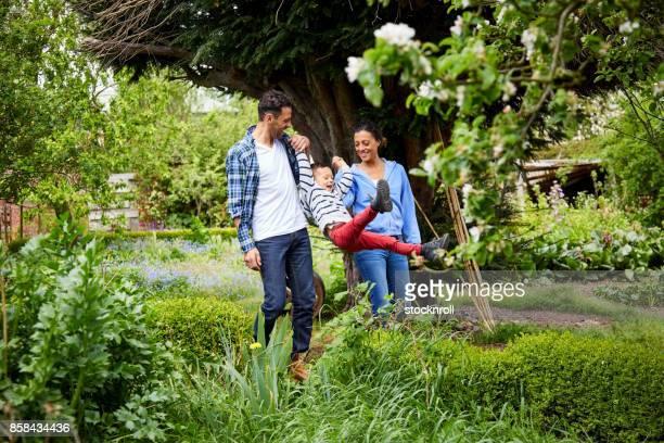Happy family having fun in garden