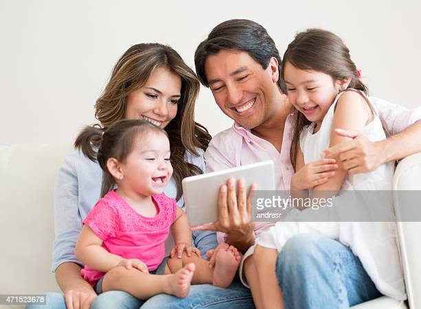 Happy family having fun using a tablet