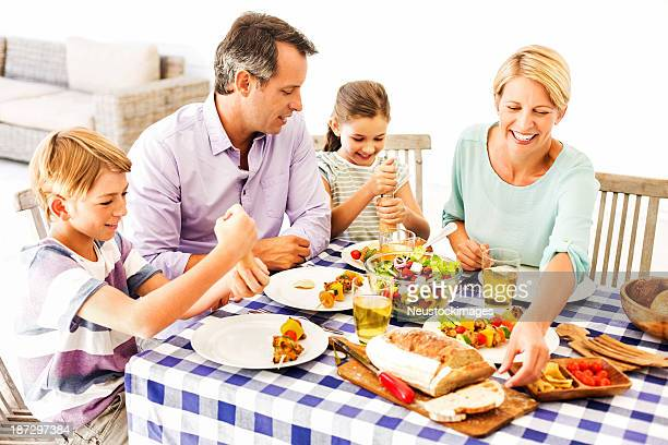 Happy Family having Lunch Together At Home