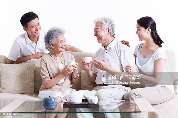 Happy family having tea and chatting
