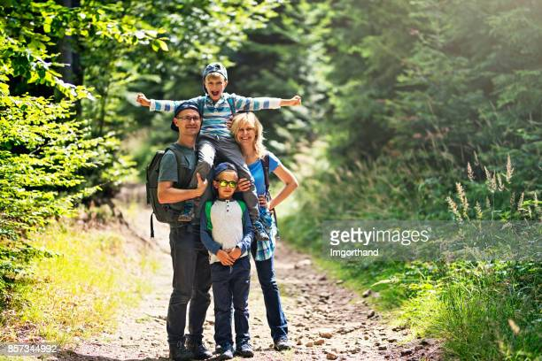 Happy family hiking in forest