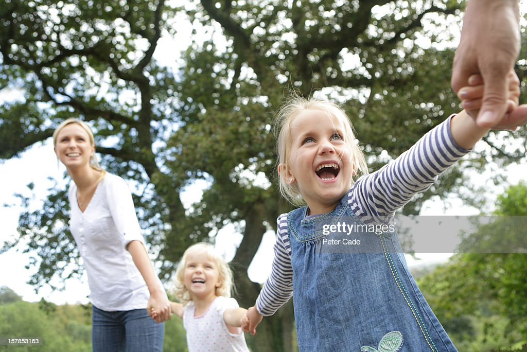 Happy family holding hands : Stock Photo
