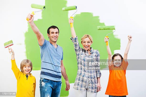 Happy family holding Work Tools