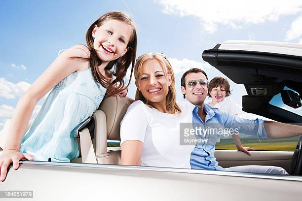Happy family in a convertible car
