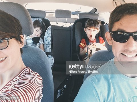 Happy Family In Car For Road Trip
