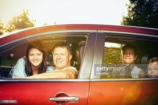 Happy Family in car ready for travel