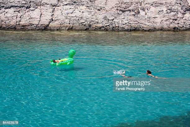 Happy family in crystal waters