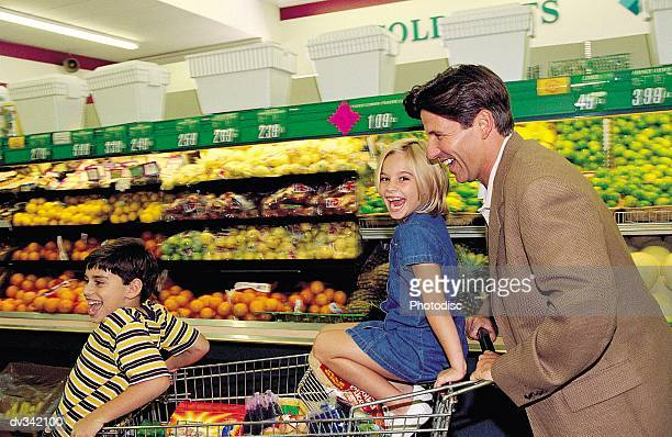 Happy family in grocery store