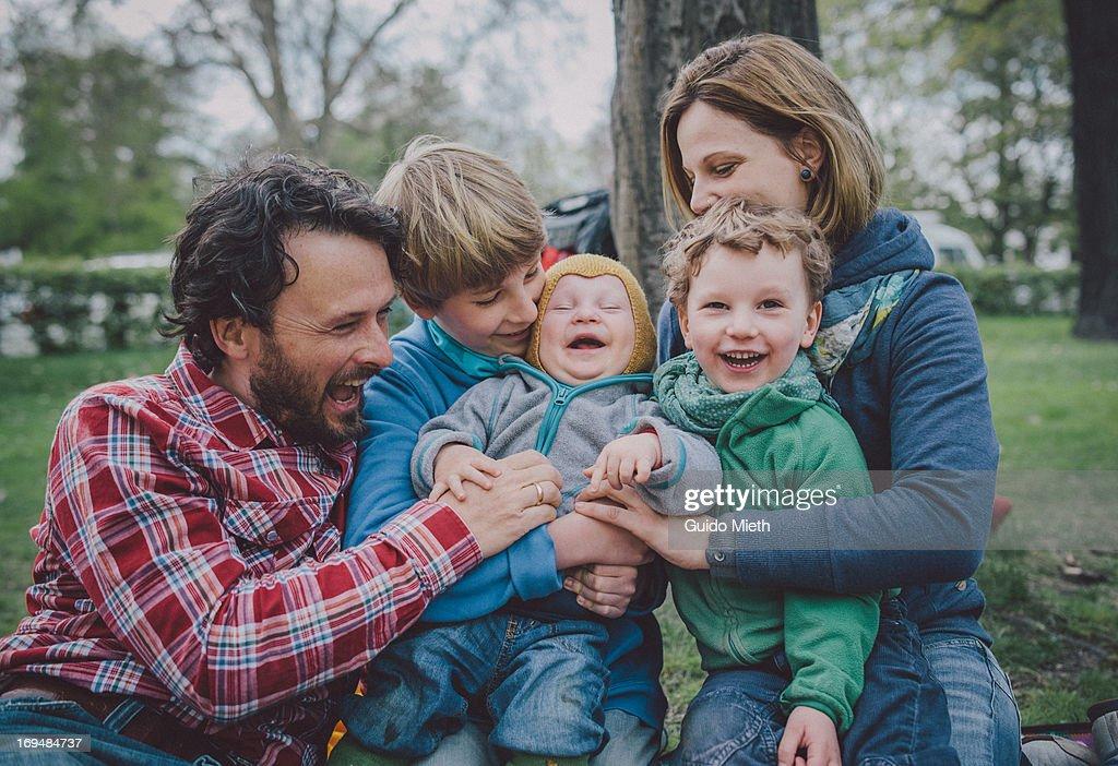 Happy family in park.