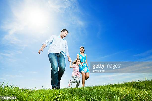 Happy family in park taking a walk.