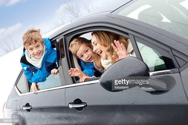 Happy family in the car on winter day
