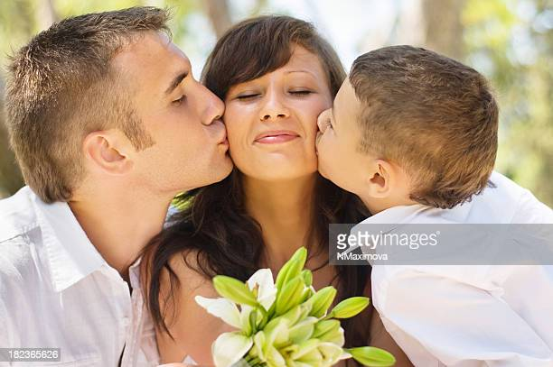 Happy family kissing.