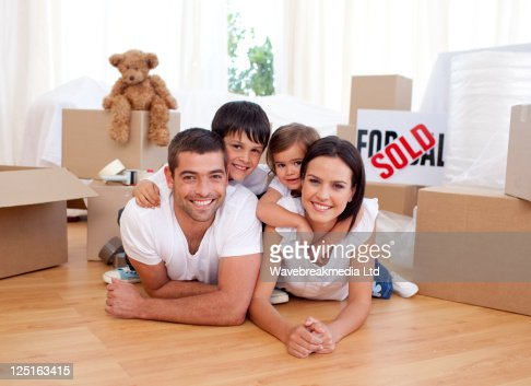Happy family after buying new house : Stock Photo