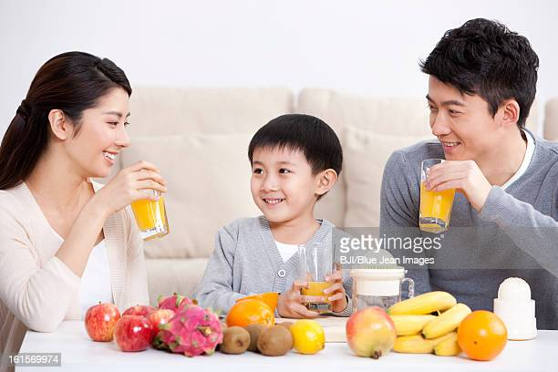 Happy family making juice at home