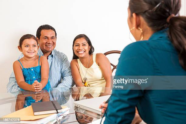 Happy family meeting with a professional person