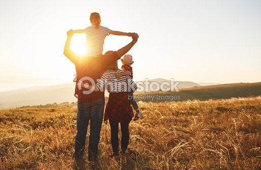 Happy family: mother, father, children son and daughter on sunset : Stock Photo
